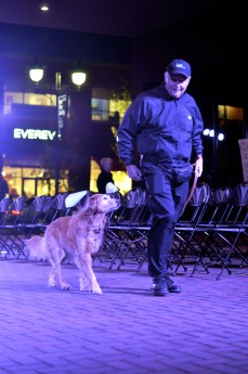 A man and his dog prepare for their runway debut prior to the fashion show.