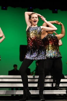 """Zoe Nolte '22 sings and dances to Showtime's rendition of """"Ain't Nothin' Wrong With That"""" by Robert Randolph and the Family Band at Liberty High School."""