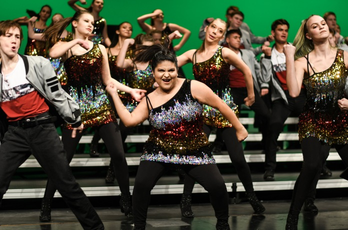 """Maria Gamon '19 performs """"Freedom"""" by Eddie James alongside Showtime, West's junior varsity show choir at Liberty High on Wednesday, Jan. 9."""