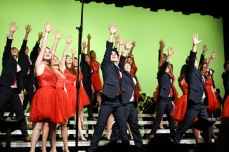 """Liberty High's show choir, Liberty Storm, poses at the end of their performance of """"Where the Streets Have No Name"""" by U2 on Wednesday, Jan. 9."""