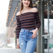 Furlong pairs a strapless top from Forever 21 with jeans as she models in downtown Iowa City.