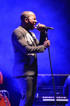 Leslie Odom Jr. sang at an outdoor concert on a stage outside of Hancher. Smoke and bright, colorful lights characterized his performance on Oct. 1.