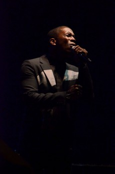 """Leslie Odom Jr. passionately sings a number from his new album, """"Joey Joey Joey"""" to an outdoor crowd at Hancher Auditorium on Sunday, Oct. 1."""