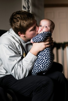 Noah Breitbach '19 kisses his six-month-old daughter, Stella Mae Breitbach, on Wednesday, Nov. 28.