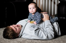 """Noah Breitbach '19 holds Stella after playing with her on the floor. He says that, """"She just makes us laugh all the time."""""""